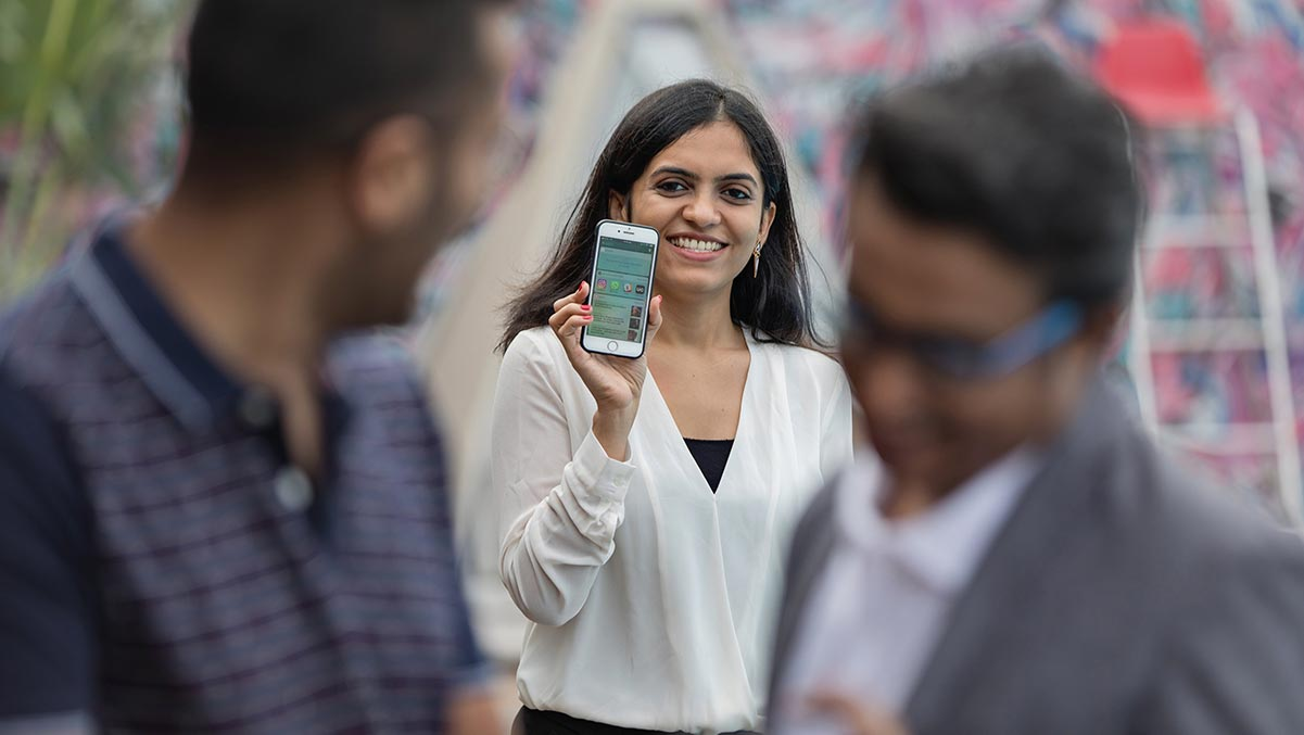 woman holding up mobile smartphone