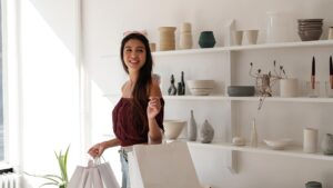 woman with white crisp shopping carrier bags
